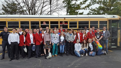 Group of students with school bus