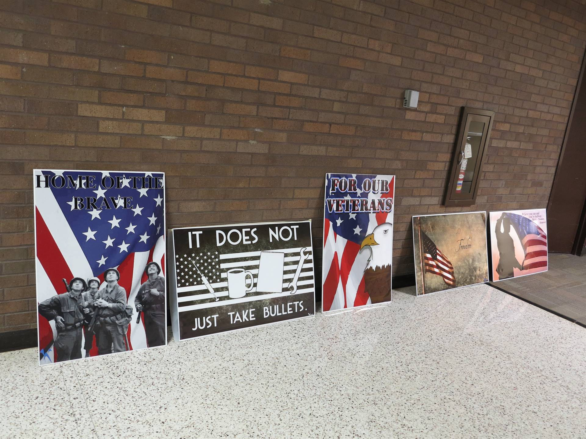 Graphic Arts students made posters, buttons and notepads for the veterans