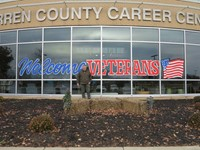 Welcome Veterans sign with artist
