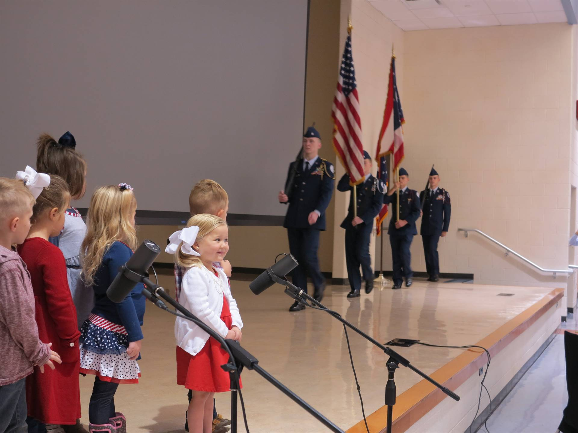 Preschoolers singing to the veterans