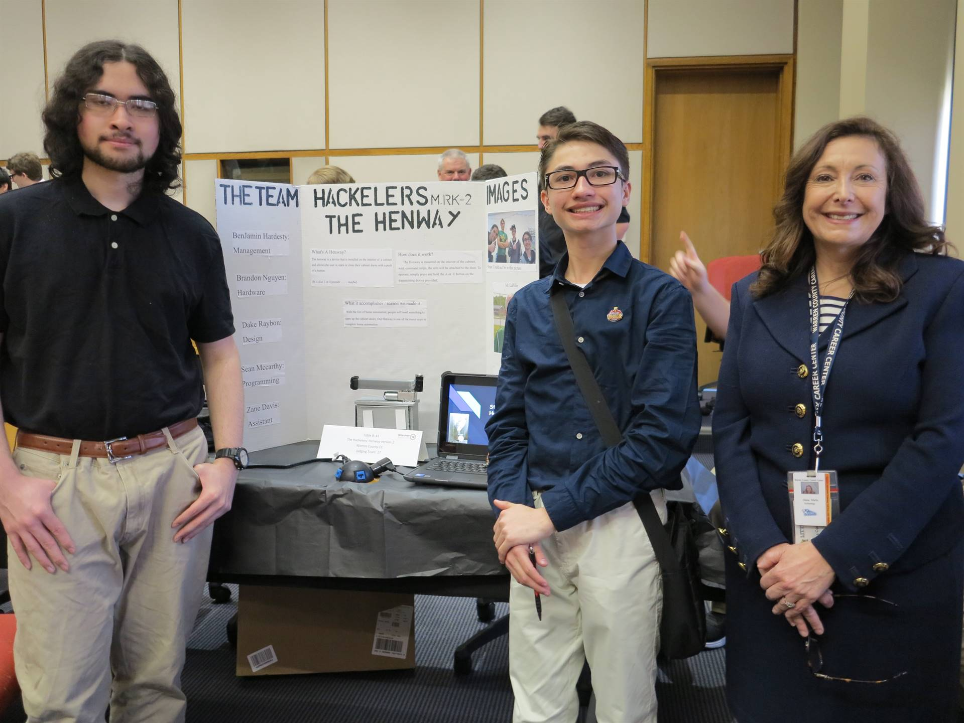 Students with project exhibit