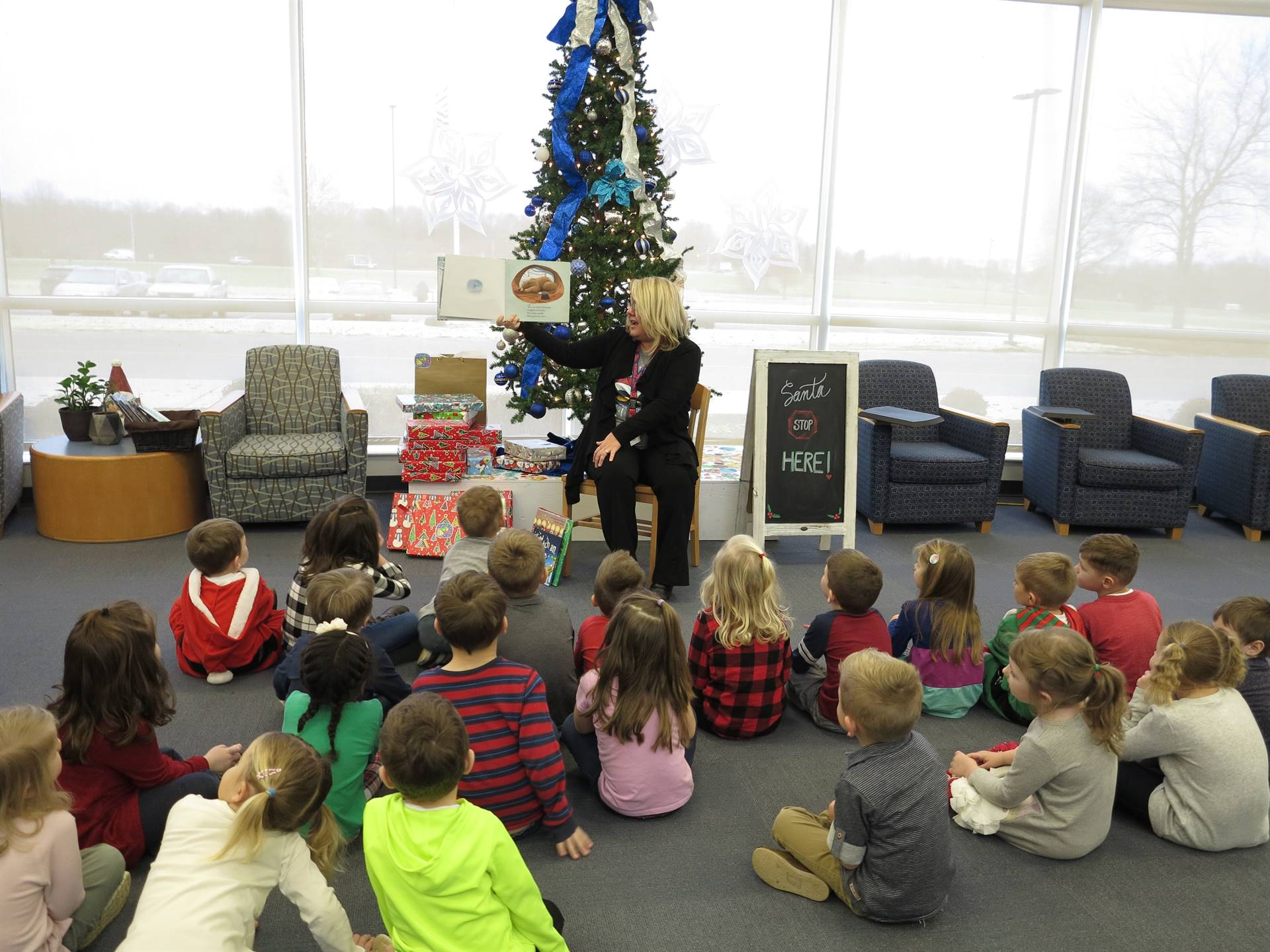 Storytime by the tree with preschoolers