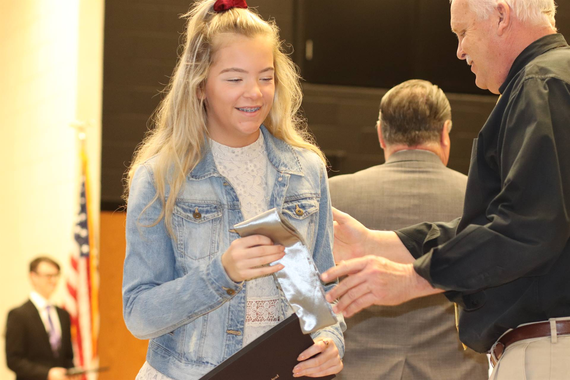 Student accepting award