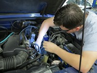 Student working on car engine