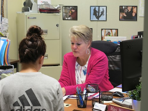 Financial Aid coordinator working with student