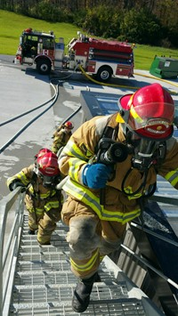 Fire science students climbing steps